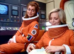"""Maya (Catherine Schell) and Helena Russel (Barbara Bain) prepare to descend to a planets surface in Space 1999 episode """"The Immunity Syndrome"""""""