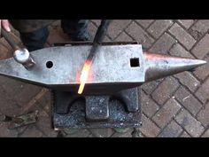 Forging flat nib tongs of two railroad spikes - YouTube