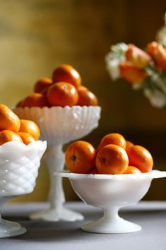 love this arrangement of oranges in milk glass bowls