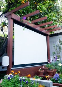 Thyme: How to Build an Outdoor Theater in Your Garden A DIY outdoor movie theater is just what your backyard needs this summer.A DIY outdoor movie theater is just what your backyard needs this summer. Backyard Projects, Outdoor Projects, Backyard Patio, Backyard Landscaping, Diy Patio, Landscaping Ideas, Backyard Privacy, Landscaping Software, Outdoor Patio Ideas On A Budget Diy