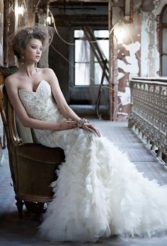 Brides:+Lazaro.+Beaded+and+embroidered+fit+and+flair+gown,+sweetheart+neckline,+organza+skirt,+chapel+train.