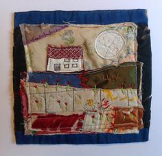 House and moon. Textile / fibre wall art collage. Original appliqué and embroidery onto vintage patchwork quilt block.