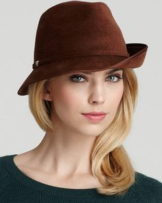 If you don't own a chic hat, get one (or three). Hats not only protect your face from the sun, they can help you hide a weird hair day. This Helen Kaminski fedora ($275) sums up posh refinement. Tu...