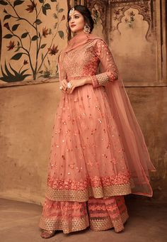 Peach Thread Embroidered Party Wear Sharara Suit is feminine and appealing and excellent pick for any special occasion. This elegant set is curated with designer thread embroidery on net kurta with. Nikkah Dress, Pakistani Bridal Dresses, Anarkali Dress, Anarkali Suits, Pakistani Sharara, Mehndi Dress, Cape Lehenga, Wedding Salwar Suits, Pakistani Suits