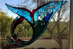 Free hanging stained glass by James Hubbell.