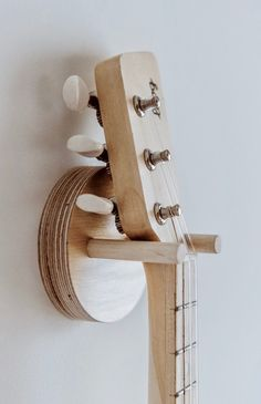 Loog Wall Hanger Made with baltic birch Easy installation, saves space and looks great at home Screws and plastic dry-wall mount included Suitable for all Loog models (and ukuleles! Ukulele Wall Mount, Guitar Wall Hanger, Guitar Wall Hooks, Guitar Wall Stand, Wooden Guitar Stand, Ukulele Stand, Guitar Storage, Guitar Display, Wooden Walls