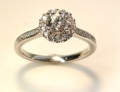 Halo design engagement ring featuring a canadian diamond.  www.troyshoppejewellers.com