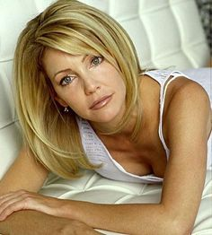 Heather Locklear's longer bob with bangs....Very Timeless, Classy, & just Cute!