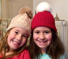 Δεξιά/Right: Κόκκινο χειροποίητο πλεχτό μάλλινο σκουφάκι με πραγματικό γούνινο άσπρο πομ πομ / Red handmade knitted woolen hat with real fur white pom pom  Αριστερά/Left: Μπεζ χειροποίητο πλεχτό μάλλινο σκουφάκι με πραγματικό γούνινο μπεζ πομ πομ / Beige handmade knitted woolen hat with real fur beige pom pom