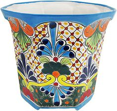 These Talavera planters feature wonderfully intricate floral patterns that will look great with your plants, indoors or out!  The ceramic of these Talavera planters is hand-painted in Dolores Hidalgo, Mexico, and embodies all the classic charm of Mexican Talavera.  Available in several shapes and sizes, all Talavera planters also feature a convenient drain hole.  Let the bright colors and your plants breathe life back into your home decor!