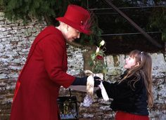 Queen Elizabeth II received flowers from a little girl as she left the church in Sandringham in London on Dec. 25, 2009.