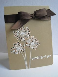 handmade card ... one layer ... kraft ... white embossed flower ... pearly raised spots ... like  how the deep brown bow matches the small dots ... would be a great card for a male ....