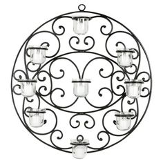 Found it at Wayfair - Tealight Candle Wall Decor in Blackhttp://www.wayfair.com/daily-sales/p/The-Finishing-Touch%3A-Rugs%2C-Pillows-%26-More-Tealight-Candle-Wall-Decor-in-Black~FV28938~E14174.html?refid=SBP.rBAZKFP52rRtuGVmaFXiAlq8azAKnESyo65M5LcJJJ0