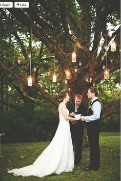 Simple outdoor wedding. LOVE the lanterns hanging in the tree above. Also love the idea of getting married under a tree.