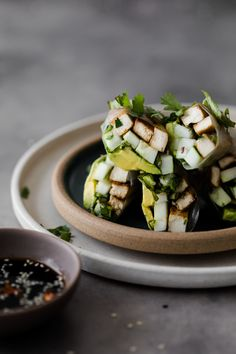 Fresh and simple avocado spring rolls packed with pan-fried tofu, cucumber, and loads of herbs. A perfect lunch or car-ride snack. Vegan Lunch Recipes, Tofu Recipes, Healthy Recipes, Recipies, Healthy Wraps, Healthy Food, Dinner Recipes, Healthy Eating, Coconut Bacon