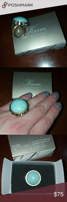 """Lia Sophia Kiam Collection Ring - Size 8 Turquoise stone in matte gold metal setting with grey/clear side stones around the center stone.  Solid heavy ring. Great statement piece!  Dimensions:  1"""" diameter. Ring setting sits 0.5"""" off of hand.  Bought from a Lia Sophia party a few years ago.  Worn a few times, and still looks great. Comes with original box. Lia Sophia Jewelry Rings"""