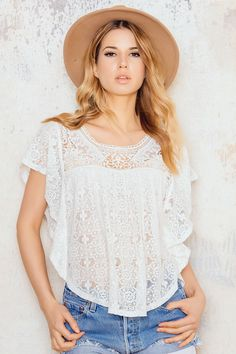 Sweet lace blouse in white from Vero Moda with short butterfly sleeves and with crochet along the front. The blouse has rounded neckline and decorative crochet and lace details in the front and at the back. Just add a pair of ripped denim shorts and a pair of heels. Suzana Lelic