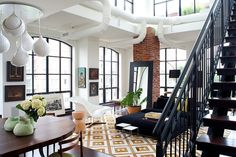 Warm eclectic penthouse condo situated in Rosslyn, Virginia, designed by Washington-based Design Milieu.