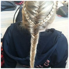 Two French braids that continued as normal braids which were added into a French fishtail on my volleyball teammate. Works for sports, but probably will hold better with hairspray.