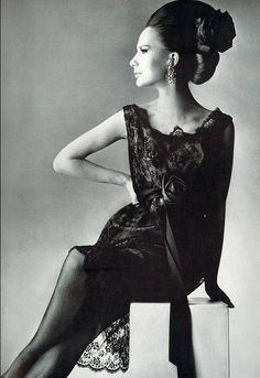 1965 Brigitte Bauer is wearing a black Chantilly lace cocktail dress by Rudolph, photo by Penn for Vogue