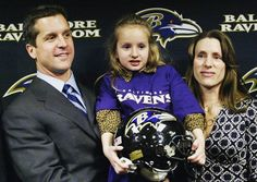 Ravens head coach John Harbaugh with wife and daughter at press conference