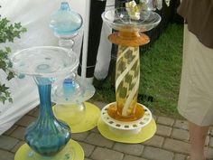 Love these bird baths made from misc. glassware, plates, vases....