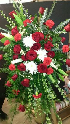 Red & White Spray  This large spray created with roses, carnations and mums makes a memorable piece.