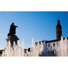 Fountain with a statue at Place Francois Mitterrand Cahors Lot Midi-Pyrenees France Canvas Art - Panoramic Images (36 x 24)