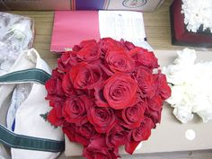 floral centerpieces black linens and napkins | Jeniece's bouquet was made up of red Freedom roses. Ferris wore a ...