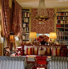 Red damask, stripes, books, lush flowers, lamps