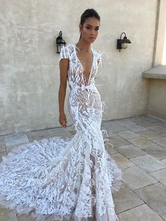 A sexy regal mermaid wedding gown with plunging neckline, cap sleeves and embroidery on sheer fabric // Yesterday, you saw our Asia Exclusive: Berta Fall/Winter 2018 Seville Bridal Collection feature here on The Wedding Scoop. Today we are sharing more photos of these stunning dresses from the collection, taken at New York Bridal Fashion Week.