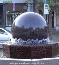 A stunning granite floating ball water feature. The granite ball has the illusion of floating as the contained pump circulates the ball round and round. The feature is available in many colours and sizes. Sphere Water Feature, Water Fountain Design, Power Balls, Water Features In The Garden, Garden Fountains, Dream Garden, Solar Power, Solar Panels, Granite