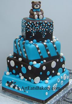 Three tier chocolate brown and blue polka dot boy baby shower cake with edible teddy bear topper
