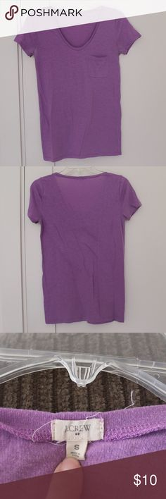 Women's J. Crew Factory Purple Shirt Small This nice J. Crew Factory shirt is in awesome condition. The armpits show a bit of wear/discoloration, but otherwise no rips stains or tears. It's light and fun, great for the summer. 52% polyester, 35% cotton, 13% rayon. J. Crew Tops Tees - Short Sleeve