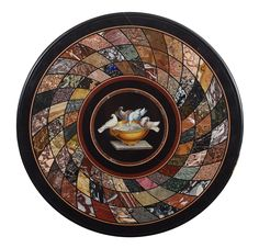 A Roman Marble Inlaid and micromosaic circular table top, 19th century. The circular marble slab inlaid with pietra dura artwork spiraling towards a center plaque in micromosaic depicting the famous Plum trees. Rome, 19th century – Dim: Diam: 78cm