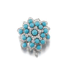 TURQUOISE AND DIAMOND BROOCH, 'FLOWER', BULGARI, 1962. Designed as a flower, set with cabochon turquoise and brilliant-cut diamonds, signed Bulgari, French assay marks, pouch stamped Bulgari.