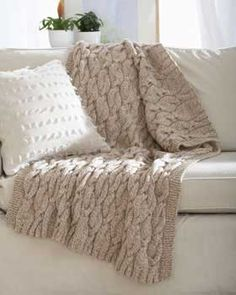 Softee Chunky Twists Cable Knit Blanket. Says the skill level is easy... We'll see!