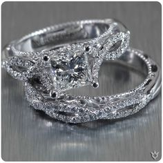 Verragio white gold, diamond encrusted, twisted shank band, princess cut center stone and a matching diamond wedding ring