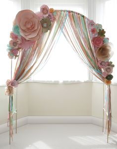 Good indication of colour scheme, peach, mint, coral, pink Paper flower wedding ceremony arch with ribons www.thingsbylaura.co.uk