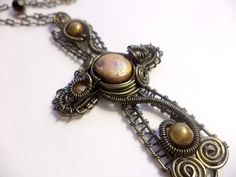Golden Celtic Cross Wire Wrap Necklace by flightfancy on Etsy, $48.00