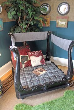 dog bed made from upside down coffee table/end table. very cute if you have the space. Could make a reading nook for kids. Just put a sheet over the legs and it's their kid cave.