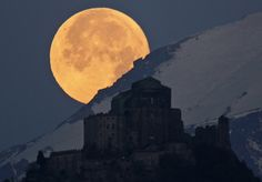 Full moon setting behind Alps and the Sacra of San Michele Italy National Geographic Photo Contest 2012 - The Atlantic Big Moon, Full Moon, Crazy Moon, Beautiful Moon, Beautiful World, Beautiful Places, Beautiful Scenery, Beautiful Landscapes, National Geographic Photo Contest