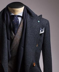 Peak collar tip coat paired with double breasted suit and polka dot tie. Perfect layering for winter!