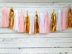 You will receive a tissue tassel garland kit with 15 tassels for assembling a 6 ft. long garland. Kit includes pink, white and metallic gold
