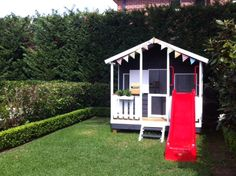 Painte Cubby House with Bunting and a red slide!