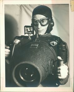 Bill Buie was a photographer on airplanes during World War II. This picture shows him with one of his camera.