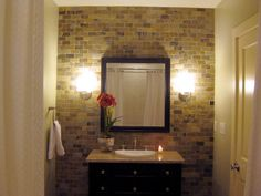HGTV fan jlgraddy made some smart design choices in this dramatic basement bath makeover. The stone is used on the back wall for maximum visual impact. The vanity was also a bargain find.
