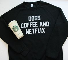 Make sure everyone knows where your priorities lie with this Dogs, Coffee and Netflix sweatshirt. About This Shirt: An everyday crew neck sweatshirt with raglan sleeves for a vintage-inspired look. Co