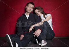 couples posing | Portrait of a young couple posing in studio - stock photo
