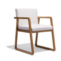 Carrera Arm Chair — Buttery white leather meets cool beech wood in the Carrera Arm Chair, a luxurious study in positive and negative space.